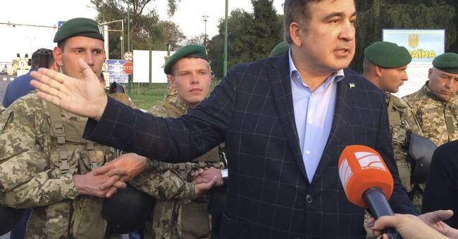 The Latest: Saakashvili, backers break through into Ukraine