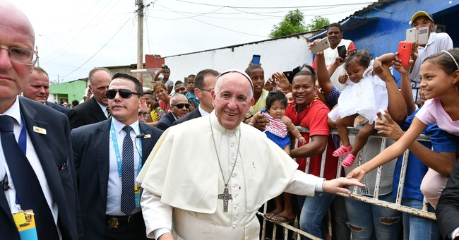 Sporting a black eye, pope urges Colombians to reconcile