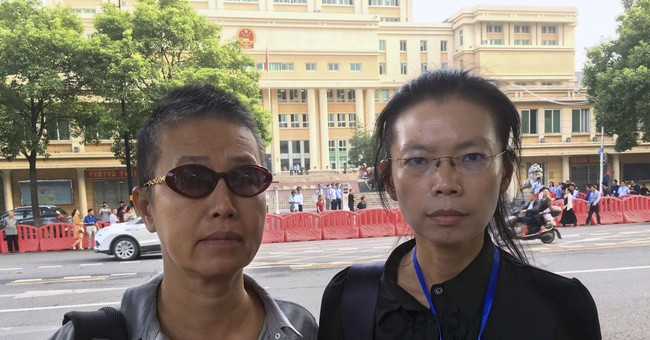The Latest: Taiwan activist pleads guilty in China