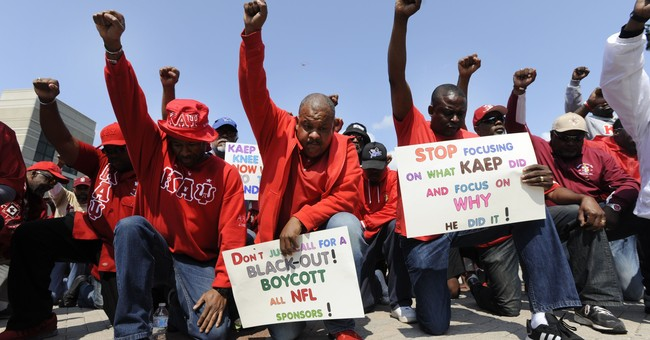Kaepernick's frat and players protest on 1st NFL Sunday