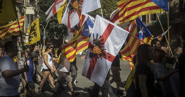 The Latest: Catalonia celebrates promised independence vote
