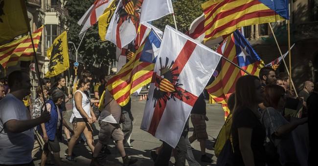 The Latest: Catalonia celebrates promised independence vote