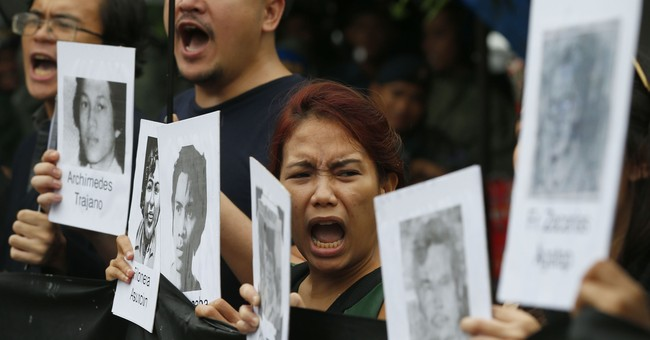 Protests hound late Filipino dictator's birthday celebration