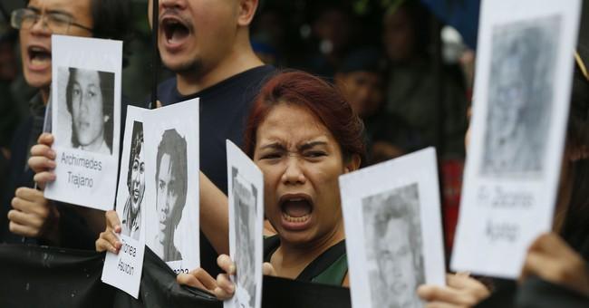 Protests hound late Filipino dictator's birthday celebration
