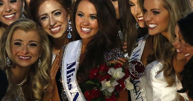 Crossing Trump on climate, new Miss America fears no tweet