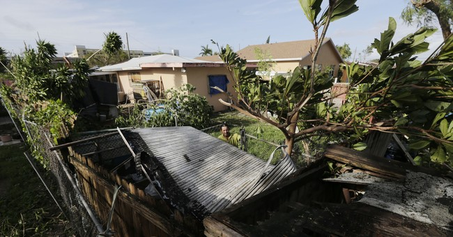 With ground still soaked, Florida town works on recovery