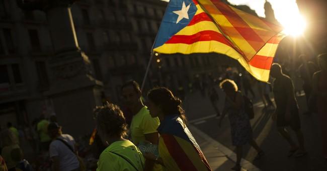 The Latest: Spanish king criticizes Catalan referendum