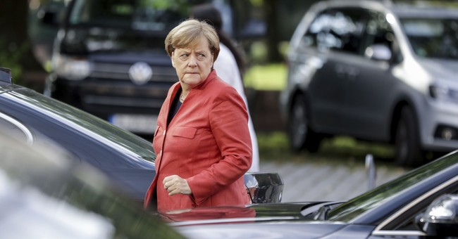 The Latest: Germany says EU migrant ruling must be accepted
