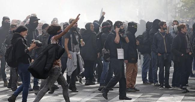 The Latest: Paris protesters: Labor changes favor employers