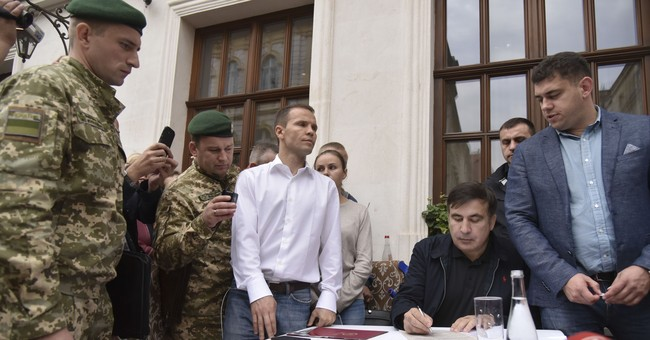 The Latest: Saakashvili to face court over border crossing