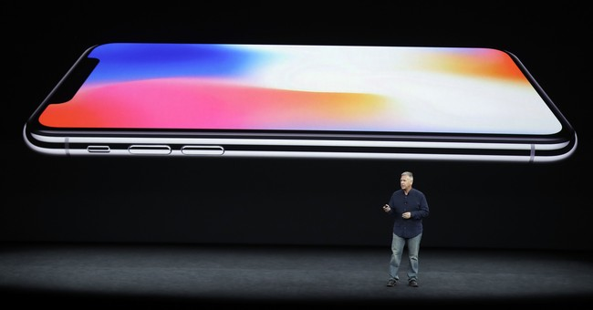 The Latest: Apple may bring facial recognition to mainstream