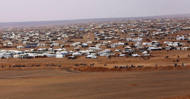 Thousands of stranded Syrians flee border camp near Jordan