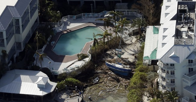 The Latest: Irma's cost to Florida already exceeds Matthew's