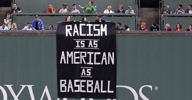 Fans denounce racism with sign above Green Monster