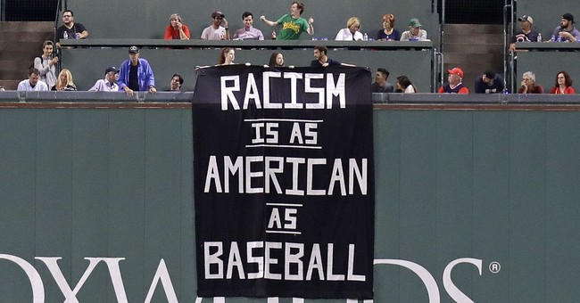 Racism banner gets fans removed from Fenway Park in Boston