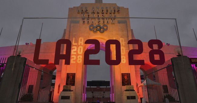 The Latest: Macron offers congratulations to Paris for 2024