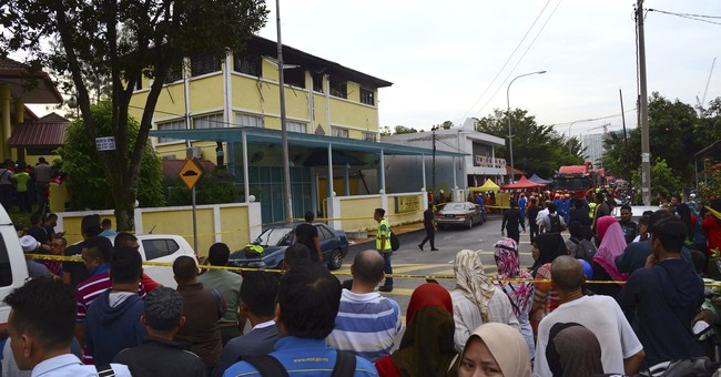 The Latest: Malaysia lowers death toll in dorm fire to 23