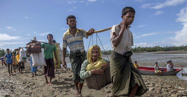 Amnesty decries 'campaign of burnings' targeting Rohingya