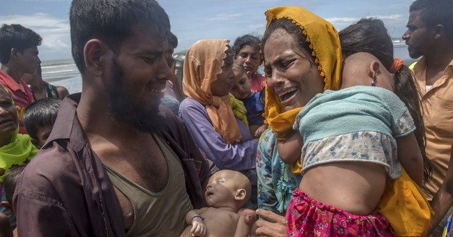 AP PHOTOS: A young Rohingya mother's horrified discovery