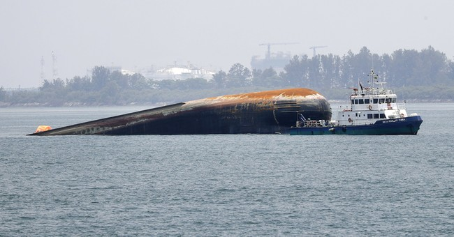 Search continues for 3 missing after tanker, dredger collide