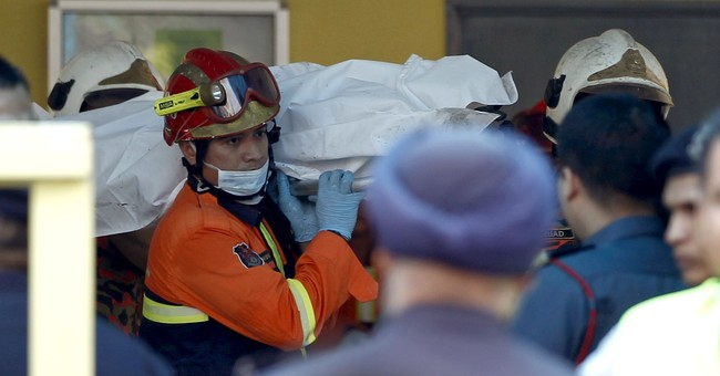 Fire blocks lone exit to Malaysian school dormitory; 23 dead
