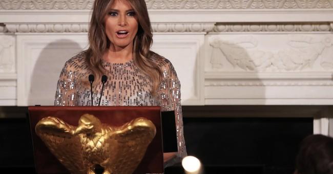 The Latest: Melania Trump salutes hurricane victims