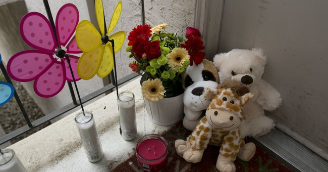 The Latest: Police say father cooperating after kids killed