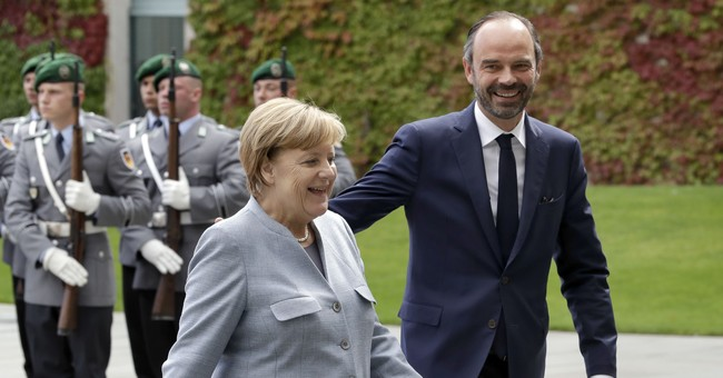 Germany's Merkel backs French reforms, says patience needed