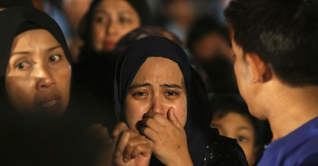Malaysia police arrest 7 boys linked to deadly school fire