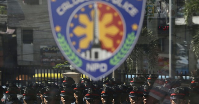 Entire Philippine city police sacked over killings, robbery