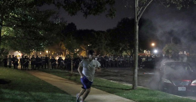 The Latest: Chief says 10 officers hurt in St. Louis protest