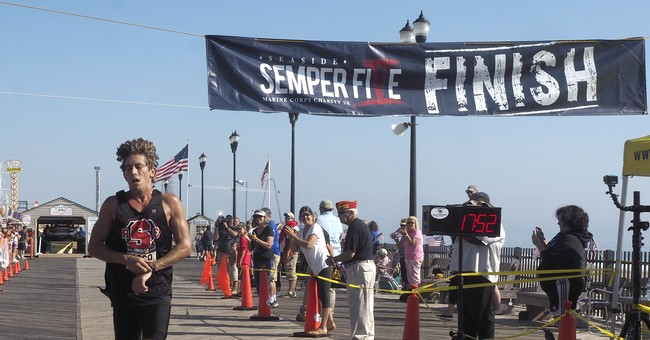Hundreds run in charity race marred last year by bombing