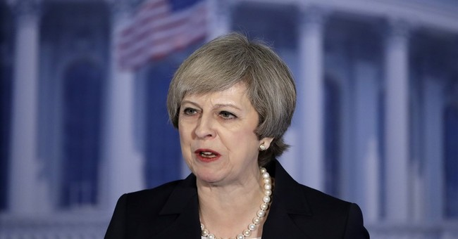UK's May praises Trump's 'renewal' but differs on torture