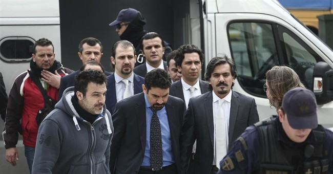 Turkey fights back after Greece denies extradition request