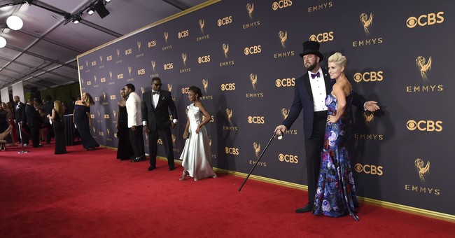 The Latest: A bar _ for engraving _ is hit at Emmys ball