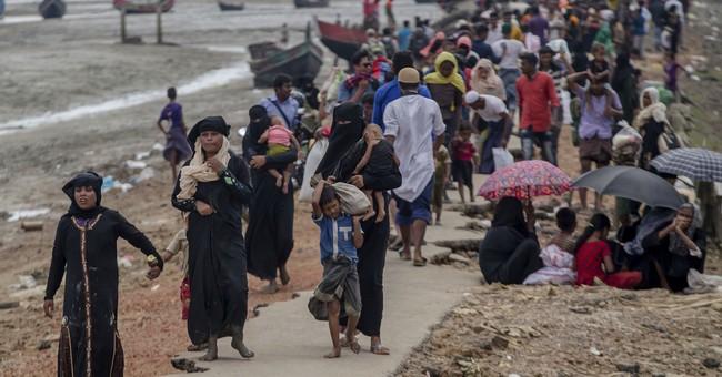 Bangladesh restricts Rohingya refugees, starts immunization