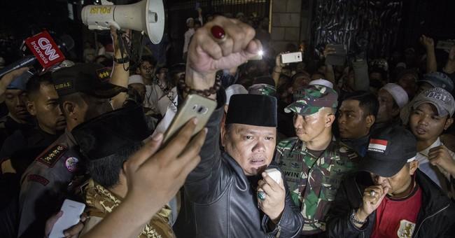 Anti-communist mob attacks Indonesia meeting, 22 arrested