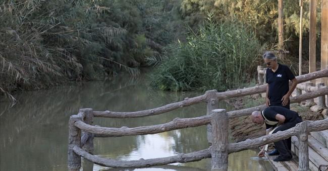 Andrea Bocelli prays at Jordan River site of Jesus' baptism