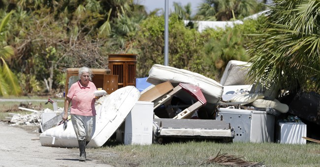SW Florida residents clear sodden homes in scorching heat