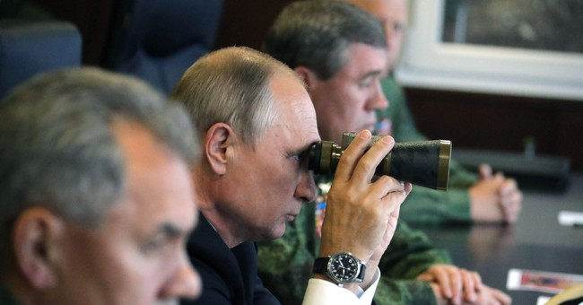Putin attends military drills that worry Russia's neighbors