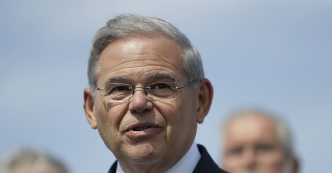 The Latest: Defense says Menendez took trips at own expense