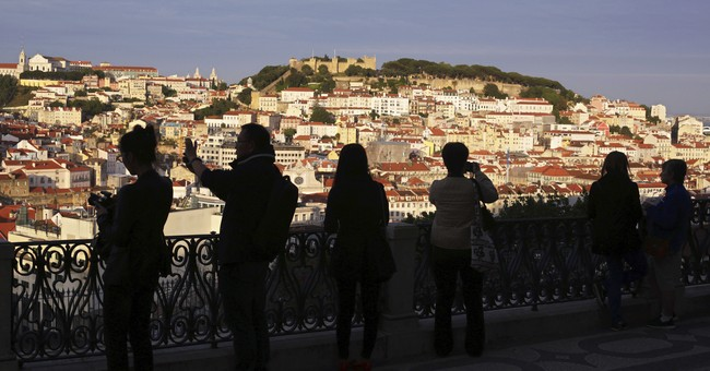 Portugal is upgraded out of junk status and its markets jump