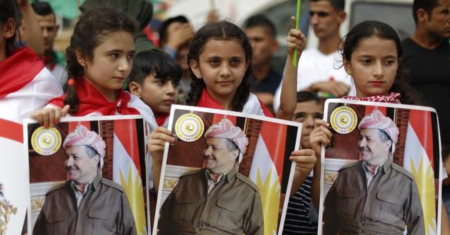 The Latest: Iraq's top court suspends Kurdish referendum