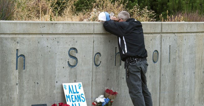 Washington state school shooting suspect pleads not guilty