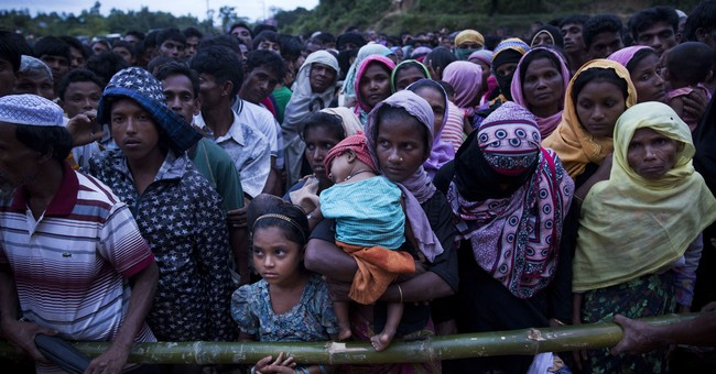 Under fire over Rohingya, Suu Kyi defends Myanmar actions