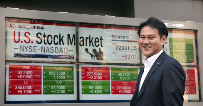 Asian shares mixed as Nikkei rises on yen, muted elsewhere