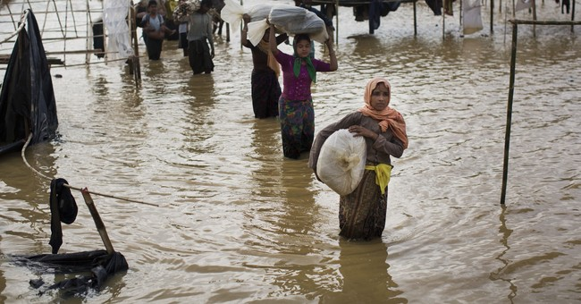 Pelting rain, relocation add to woes in Rohingya Muslim camp