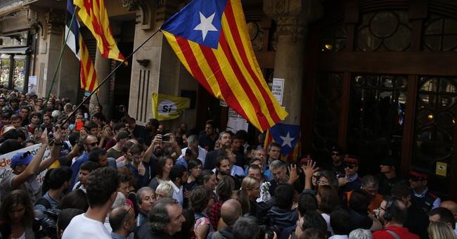 The Latest: Barca condemns efforts to halt Catalan vote