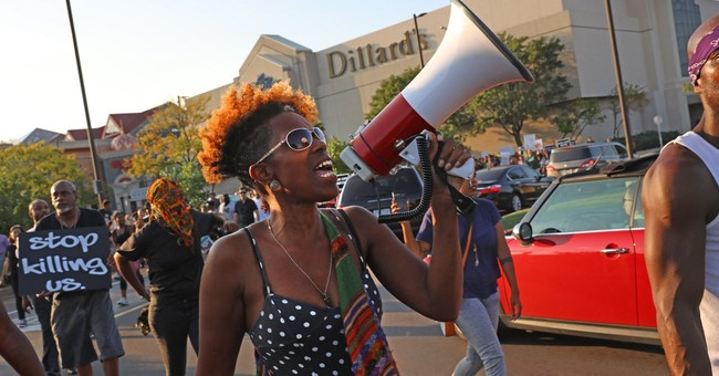 Protesters march in St. Louis suburb over police shooting