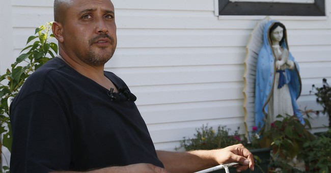 The Latest: Neighbor says man shot by cop didn't speak